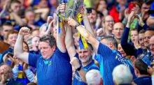 Tipperary manager Liam Sheedy lifts the Liam McCarthy trophy with members of the backroom staff after beating Kilkenny at Croke Park. Photo: Tommy Dickson/Inpho