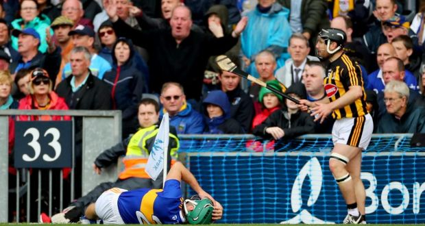 Tipperary's Cathal Barrett lies injured following the incident with KIlkenny's Richie Hogan which  resulted in a red card. Photograph: James Crombie/Inpho