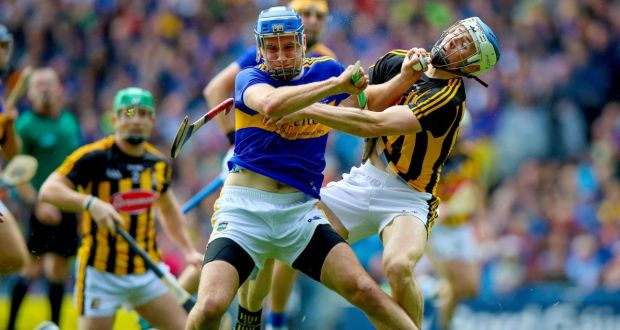 Kilkenny's Huw Lawlor and Tipperary's  John McGrath grappling  during the All-Ireland final in Croke Park. Photograph: Tommy Dickson/Inpho