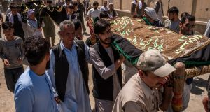 The bodies of two of the people killed on Saturday in a suicide bombing at a wedding are taken to their burial in Kabul on Sunday. Photograph: Jim Huylebroek/New York Times