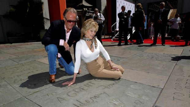 Peter and Jane Fonda look at their father Henry's handprints and footprints in Hollywood, California April 27, 2013. Photograph: Reuters/Mario Anzuoni