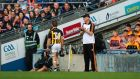 Kilkenny's Richie Hogan walks past his manager Brian Cody after being red carded. Photograph: Inpho