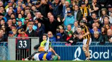 Tipperary's Cathal Barrett lies injured following the incident with Richie Hogan that resulted in the Kilkenny man receiving a  red card. Photograph: James Crombie/Inpho