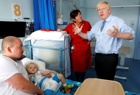 HEALTH SERVICE: Britain's PM Boris Johnson meets with patient Logan Rock during his visit to the Royal Cornwall Hospital in Truro, England. Photograph: Peter Nicholls - WPA Pool/Getty Images