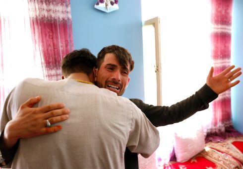 KABUL WEDDING ATTACK: Mirwais Elmi (26), an Afghan groom who survived a suicide attack at his wedding reception, greets a relative in his house in Kabul. Photograph: Mohammad Ismail/Reuters