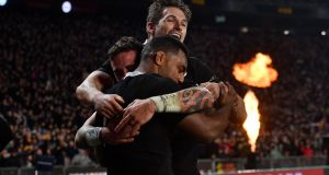 All Blacks' Sevu Reece celebrates his try with Beauden Barrett in the 2019 Investec Rugby Championship at Eden Park, Auckland on Saturday. Photograph: Marty Melville/Inpho/Photosport