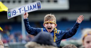 A young fan at Semple Stadium for the homecoming of All-Ireland hurling champions Tipperary. Photograph: Laszlo Geczo/Inpho