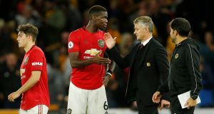 Manchester United's Paul Pogba with manager Ole Gunnar Solskjaer after the match. Photograph: Reuters