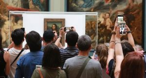Visitors take photos of the Mona Lisa in the Medici Gallery at the Louvre in Paris: Museums are magnificent but do not let them cage culture. Photograph: Owen Franken/New York Times