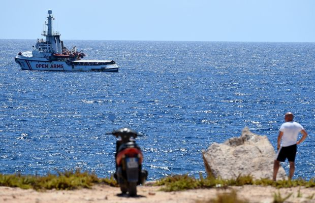 Spanish migrant rescue ship Open Arms is seen close to the Italian shore in Lampedusa, Italy on Monday. Photograph: Guglielmo Mangiapane/Reuters