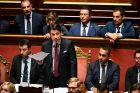 Italian prime minister Giuseppe Conte,   flanked by peputy prime ministers Matteo Salvini (left) and Luigi Di Maio,  addresses the Senate in Rome on Tuesday. Photograph: Ettore Ferrari/EPA