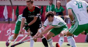 Mathias Muller of Germany and Ben Walker of Ireland vie for the ball during the  EuroHockey  match  in Antwerp, Belgium. Photograph: Stephanie Lecocq/EPA