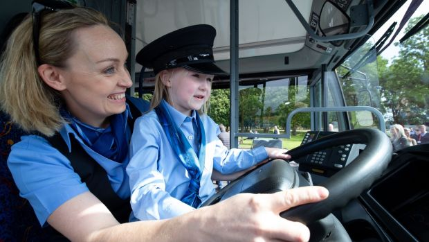 Naoise O Molloy (5) from Trim, Co Meath, with Dublin Bus driver Suzanne Armstrong at the launch of the new recruitment campaign. Photograph: Tom Honan/The Irish Times.