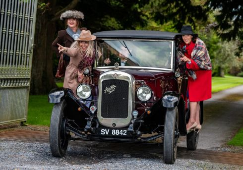 DOWNTON ABBEY: Maria Desmond of Enable Ireland Cork; Ciara Wilson of Salon Shop and Sinéad O'Keeffe of Enable Ireland Cork with Derek Wilson and his 1929 Austin 16-6 at the launch of the premiere of Downton Abbey the movie. Photograph: John Allen