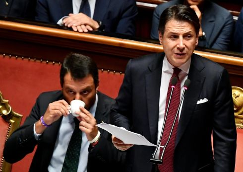 DON'T MIND ME: Italian prime minister Giuseppe Conte next to deputy prime ministers Matteo Salvini as he addresses the senate in Rome. Mr Conte announced his resignation and made a blistering attack on his interior minister accusing Mr Salvini of sinking the ruling coalition and endangering the economy for personal and political gain. Photograph: Ettore Ferrari/EPA