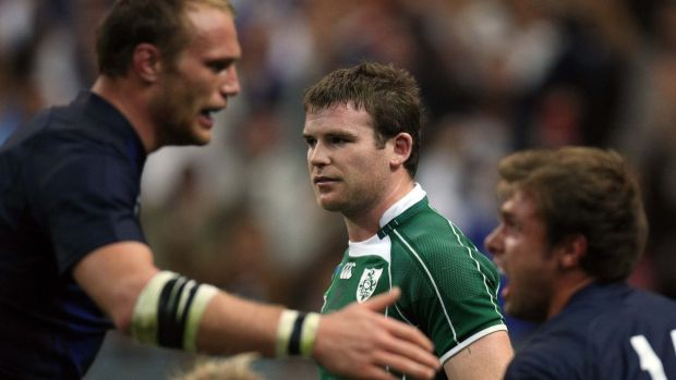 Ireland's Gordon D'Arcy dejected as France's Julien Bonnaire congratulates try-scorer Vincent Clerc during their World Cup group match in September 2007. Photograph: Billy Stickland