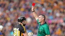Kilkenny's Richie Hogan receives a red card from referee James Owens. Photograph: Ryan Byrne/Inpho