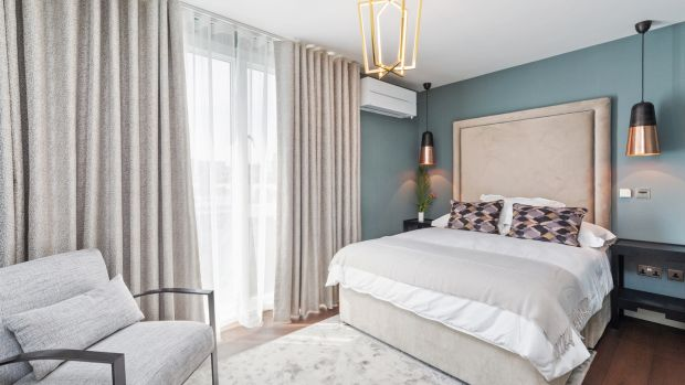 Pendant lights were added in the main bedroom. Photograph: Matteo TunizMediaPro