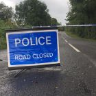 A police road block close to the scene where an explosive device was detonated in  Co Fermanagh on Monday. Photograph: PA Wire