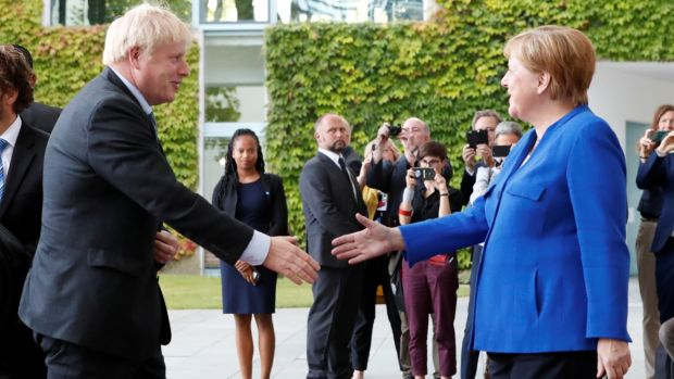 German chancellor Angela Merkel shakes hands with Britain's prime minister Boris Johnson as they meet at the Chancellery in Berlin, Germany on August 21st, 2019. Photograph: Fabrizio Bensch/Reuters.