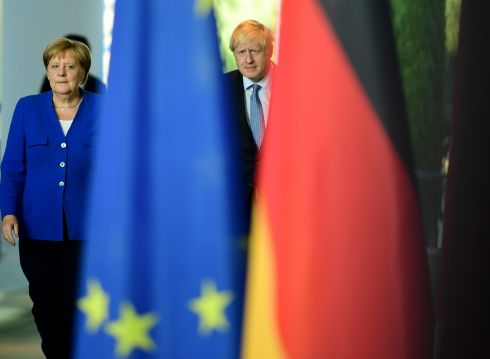 British prime minister Boris Johnson and German chancellor Angela Merkel at a joint press statement at the Chancellery in Berlin. Johnson and Merkel discussed Brexit, with the German chancellor suggesting a solution to the impasse could be found within 30 days. Photograph: Clemens Bilan/EPA