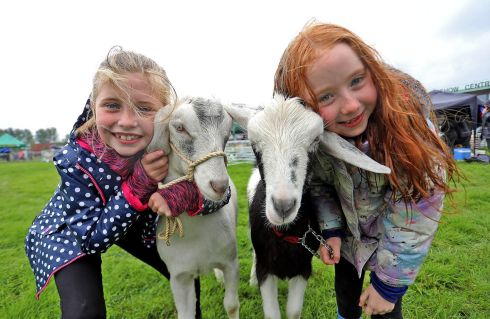 Rebecca Windrum and Alesha McAloon with their goats Millie and Minnie at the Virginia Agricultural Show in Cavan. Photograph: Lorraine Teevan
