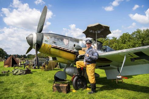 A participant with a German second World War fighter aircraft Messerschmitt BF-109 at the re-enactment camp on the first day of the annual Wings of Freedom airshow in Ede, central Netherlands. A temporary airport has been built between Ede and Veenendaal, with British, American and German war equipment, for this airshow dominated by the 75-year commemoration of the allied liberation operation Market Garden. Photograph: Piroschka van de Wouw/ANP/AFP/Netherlands Out/Getty Images