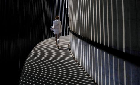 A woman walks up the spiral stairs at the Circa Gallery as part of the Keyes Art Mile in Johannesburg, South Africa. The street has become an art mile involving galleries and various restaurants in the Rosebank area of Johannesburg. Photograph: Kim Ludbrook/EPA