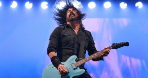 Dave Grohl in action  as the Foo Fighters play the RDS.  Photograph: Nick Bradshaw/The Irish Times