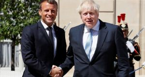 French president Emmanuel Macron welcomes British prime minister Boris Johnson before a meeting on Brexit at the Elysee Palace in Paris. Photograph: Gonzalo Fuentes/Reuters