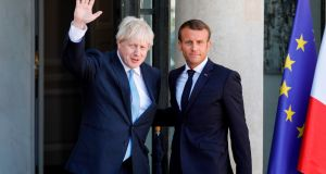 French president Emmanuel Macron welcomes British prime minister Boris Johnson ahead of a meeting at The Élysée Palace in Paris. Photograph: Geoffroy van der Hasselt/AFP/Getty Images