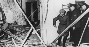 Benito Mussolini and Adolf Hitler  inspect the wreckage of  Hitler's headquarters following a failed  assassination attempt of the Nazi leader in 1944. Photograph: Keystone/Hulton Archive/Getty Images