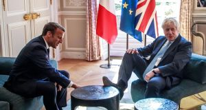 Britain's prime minister Boris Johnson places his foot on the table during a meeting with French president Emmanuel Macron. Photograph: Getty Images