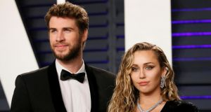 Divorcing: Liam Hemsworth and Miley Cyrus. Photograph: Reuters/Danny Moloshok