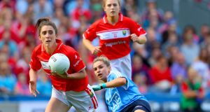 Cork's Ciara O'Sullivan with Martha Byrne of Dublin in last year's   All-Ireland final  in Croke Park. Photograph:  Oisin Keniry/Inpho