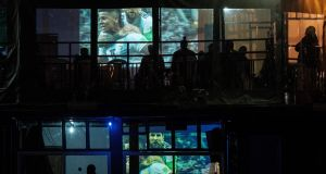 Kenyans watch football in a bar in  Nairobi: the country's sixth census involves shutting down bars so as to enumerate people. Photograph:   Yasuyoshi Chiba/AFP
