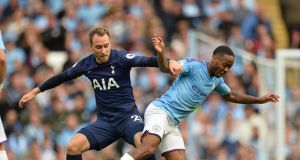 Tottenham's Christian Eriksen in action against  Manchester City's Raheem Sterling at the  Etihad Stadium in Manchester, last weekend.  Photograph: Peter Powell/EPA
