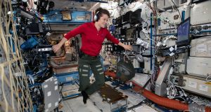 Flight engineer Anne McClain looks at a laptop computer screen inside the US Destiny laboratory module of the International Space Station in January. Photograph: NASA via The New York Times