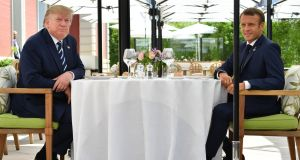 US president Donald Trump (L) sits to lunch with French president Emmanuel Macron at the Hotel du Palais in Biarritz on Saturday. Photograph:  Nicholas Kamm/AFP
