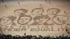 Activists use sand art to tackle G7 on gender equality