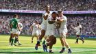 Joe Cokanasiga (L) and Tom Curry celebrate with Manu Tuilagi after the centre's try against Ireland. Photograph: Glyn Kirk/AFP/Getty