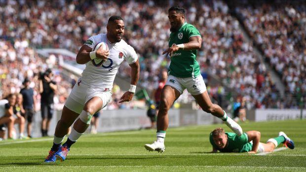 Rugby Joe Cokanasiga beats Jordan Larmour to score England's opening try at Twickenham. Photograph: David Ramos/Getty
