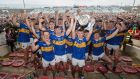 Tipperary celebrate after their Under-20 final victory over Cork in Limerick. Photograph: Tommy Dickson/Inpho