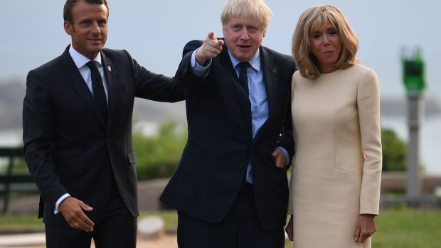 French president Emmanuel Macron and his wife Brigitte with British prime minister Boris Johnson at the official welcome during the G7 summit in Biarritz, France. Photograph: Neil Hall/PA Wire