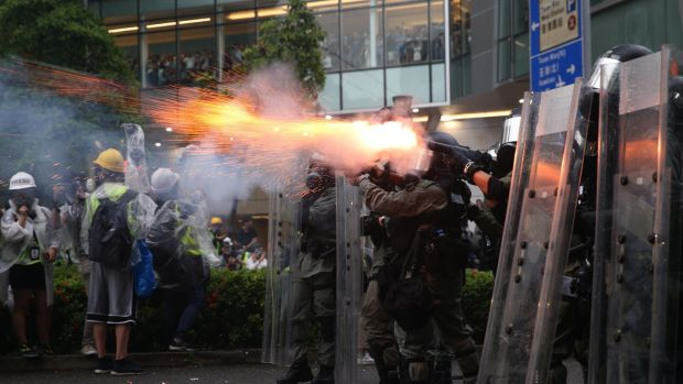 Riot police fire tear gas as protesters take part in an anti-government rally in Hong Kong. Photograph: EPA