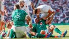 Owen Farrell gets to grips with Ireland captain Rory Best after a George Kruis try at Twickenham. Photograph: James Crombie/Inpho