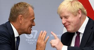 Britain's prime minister Boris Johnson (R) meets European Union Council President Donald Tusk (L) for their bilateral talks during the G7 summit in Biarritz, France on Sunday. Photograph: Andrew Parsons/EPA