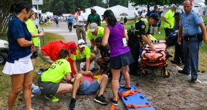 Spectators are treated after a lightning strike  injured six people during the third round of the Tour Championship golf tournament in Atlanta. Photograph: AP