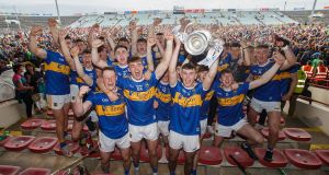 Tipperary players celebrate after winning the All-Ireland under-20 championship. Photo: Tommy Dickson/Inpho