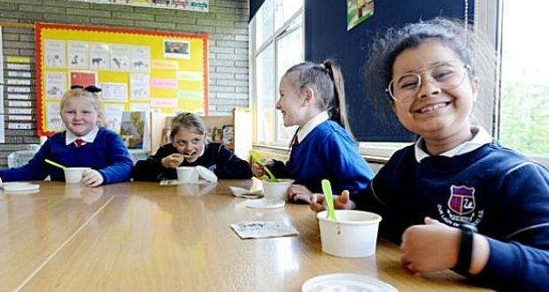 Third-class students at Our lady of Lourdes National School in Goldenbridge, Dublin, enjoying their hot lunches. File photograph: Alan Betson